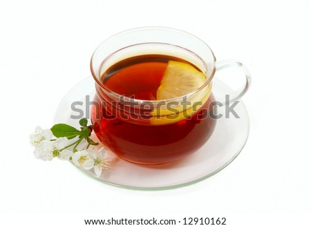 Black tea on glass cup with lemon. Isolated on white background.