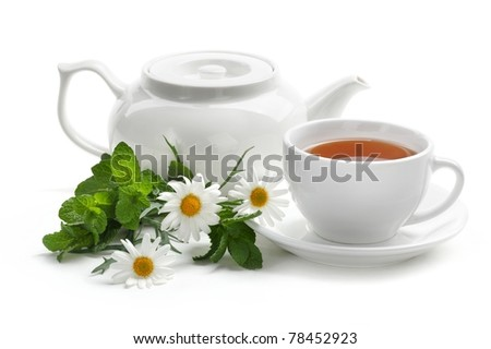 Black tea with fresh mint leaves and daisy. Isolated on white background. - stock photo
