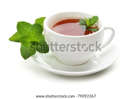 Black tea with fresh mint leaves. Isolated on white background. - stock photo