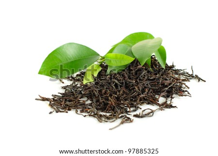 Black tea with green leaf isolated on white - stock photo