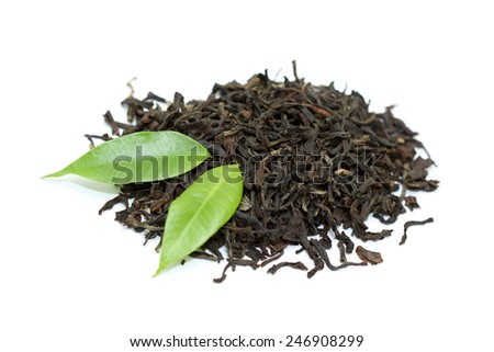 Black tea with green leaves isolated on white - stock photo