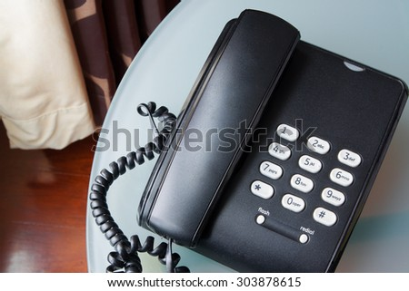 black telephone on a table  - stock photo