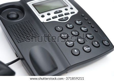 black telephone on a white background
