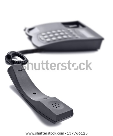 Black telephone on white with space for text - stock photo