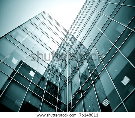 black texture of glass transparent skyscrapers at night - stock photo