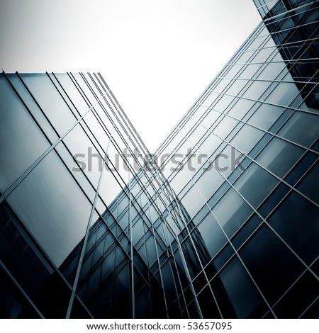 black texture of modern glass side of office building in business center - stock photo