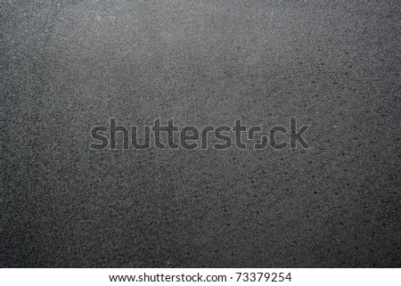 Black texture plastic. closeup Useful as background for design-works. - stock photo