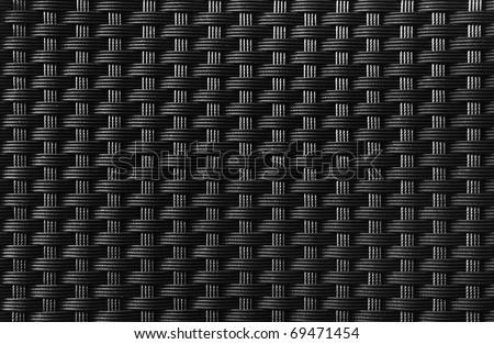 Black textured surface of interlaced nylon strings - stock photo