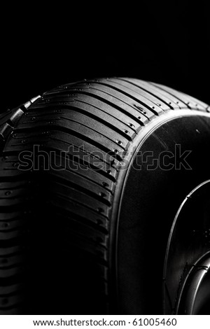 Black tire in a dark - stock photo
