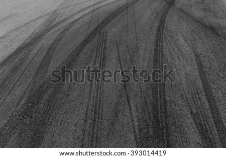 black tire tracks on racing track