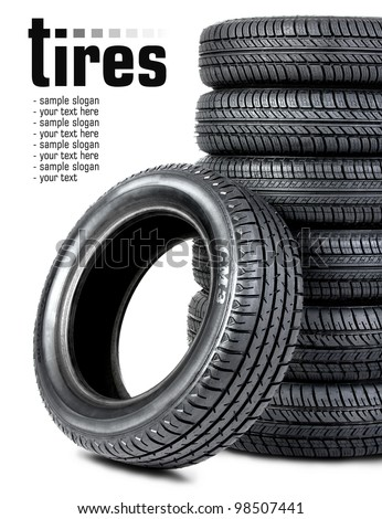 Black tires on the white background - stock photo