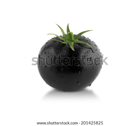 Black tomato! creative concept, something different. - stock photo