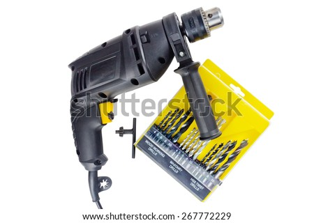 Black tool drill and drill bits a set of on a white background - stock photo