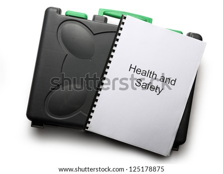 Black toolbox and notebook on white background - stock photo