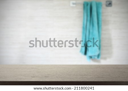 black top and towel  - stock photo