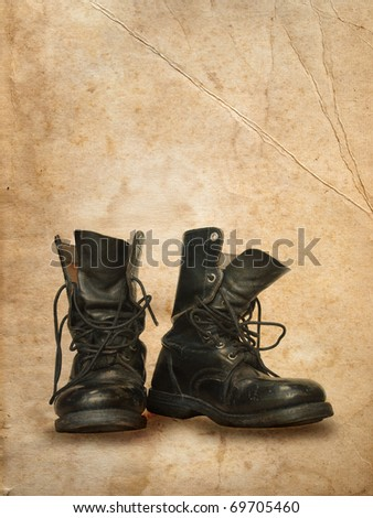 Black top boot in old brown paper - stock photo