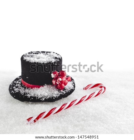 black top hat snowman with Cane, christmas card isolated on white snow background  - stock photo