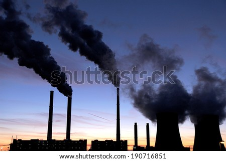 black toxic smoke from coal power plant  - stock photo
