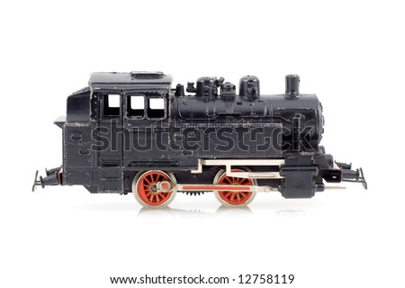 Black toy locomotive on a white