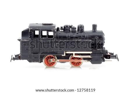 Black toy locomotive on a white - stock photo