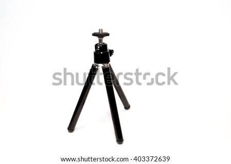 black tripod photo-video equipment is on a white background, for stability and image stabilization - stock photo