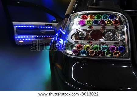 black tuning car with a lot of Light Bulb - stock photo