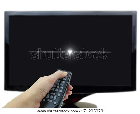 Black tv display with hand and remote control - stock photo