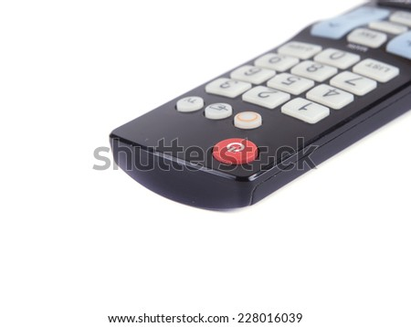 black TV remote on a white background - stock photo