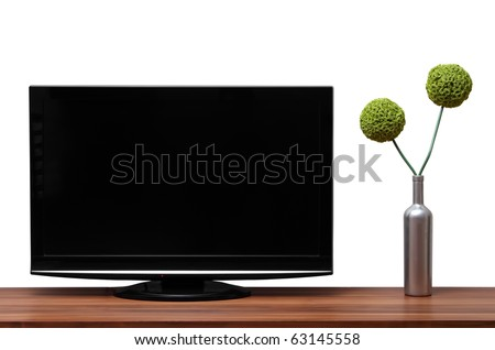 Black TV stands on a wooden shelf - stock photo