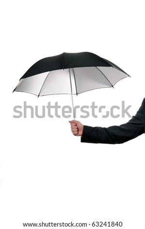 Black umbrella. Business man dressed in suite holding a black umbrella - stock photo