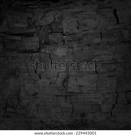 black uneven background with charcoal texture - stock photo
