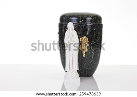 Black urn and saint figure on white background - stock photo