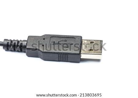 black USB cable plug on white background - stock photo