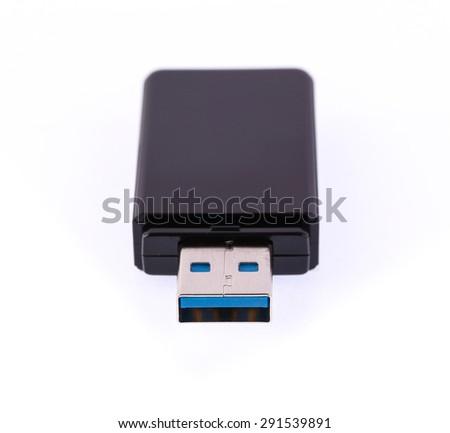 Black USB memory stick isolated on white background - stock photo