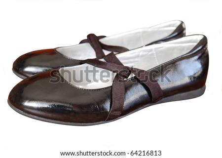 black varnished girl shoes isolated on white - stock photo