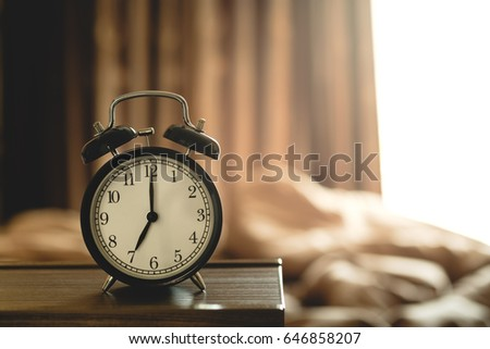 Black Vintage Alarm Clock In Bedroom Morning With Sunlight From Window