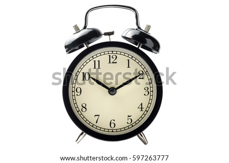 black vintage alarm clock isolated on white background with clipping path