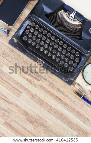 black vintage antique typewriter on working desktop with copy space, top view - stock photo