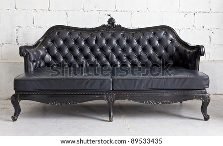 black vintage armchair in white room - stock photo
