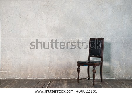 Black vintage chair in a concrete room