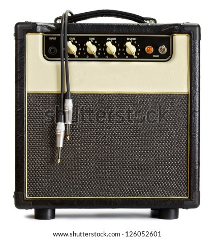 black vintage guitar aplifier with cable, isolated on white - stock photo