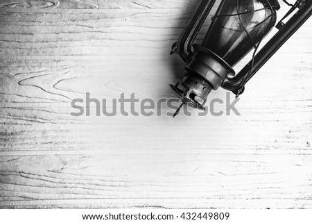Black vintage lamp on white and black pattern background.Suitable for enter text in the middle and more. - stock photo