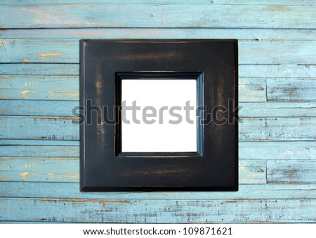 Black Vintage picture frame, wood plated, blue wood background, clipping path included