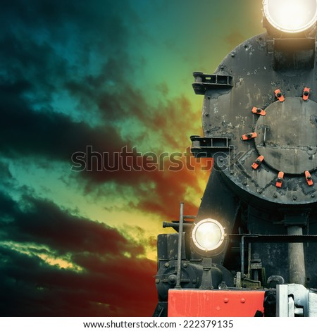 Black vintage steam train at night - stock photo