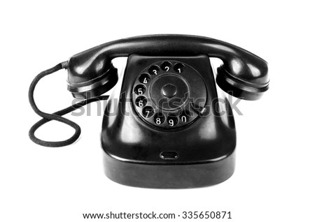 Black vintage telephone with rotary dial isolated over white background - stock photo