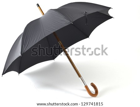 Black vintage umbrella isolated on white with some natural shadows. - stock photo