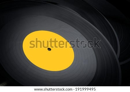 Black vinyl records stacked up closeup photo