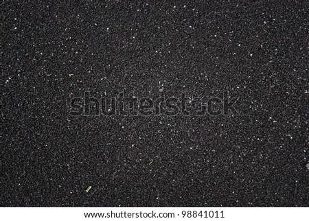 Black volcanic sand on beach in Iceland - stock photo