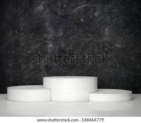 black wall and empty podium - stock photo