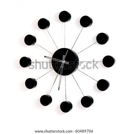 Black wall clock on white background - stock photo